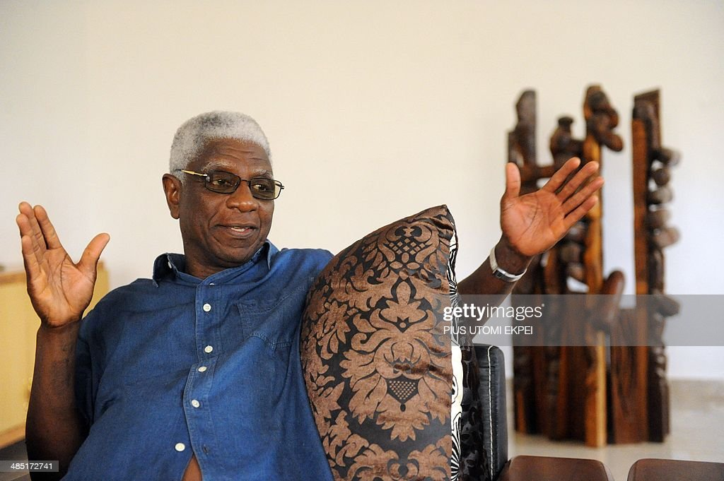 Ghanian born renowned sculptor Professor El Anatsui speaks about his forty-year career as a sculptor, teacher and exhibition to mark his 70th birthday at his Nsukka home on August 8, 2013. The Ghanaian-born Anatsui's first big step toward international acclaim happened in 1990 when he and four others became the first artists from sub-Saharan Africa invited to exhibit at the Venice Biennale, one of the world's most prestigious showcases. His prominence has grown steadily since, including shows in the world's cultural capitals but 1999 is widely seen as a turning point. AFP PHOTO/PIUS UTOMI EKPEI