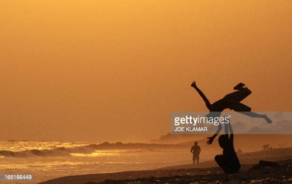 Ghanian boys practice summer saults at a beach during a sunset in city center of Accra on February 9 2008 during the Africa Cup of Nations CAN 2008...