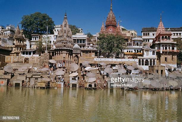 Ghats or steps down to the River Ganges at Benares or Varanasi India circa 1965