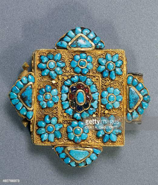 Ghau reliquary pendant in gold turquoise and rubies worn by aristocratic women Tibet