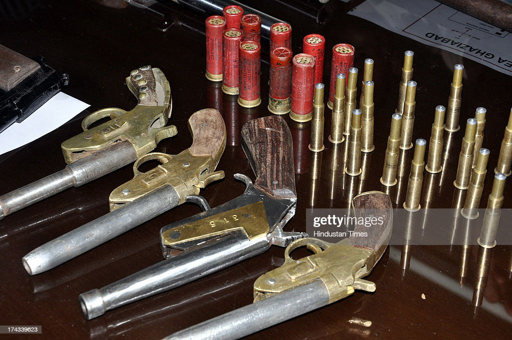 Ghaziabad Police nabbed two illegal arms suppliers and also recovered a large cache of country-made weapons from their posession on July 24, 2013 in Ghaziabad, India.