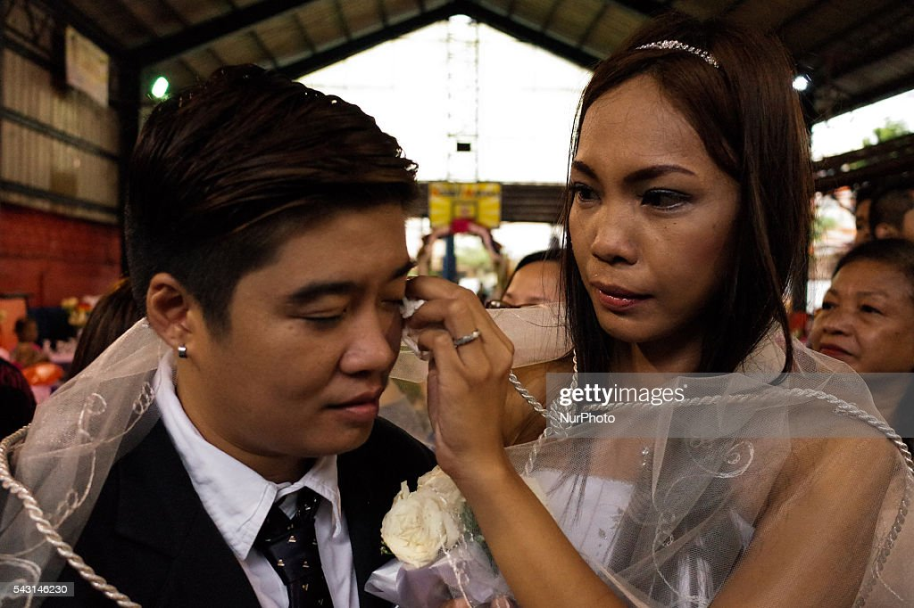 "Gheia Del Rosario wipes the face of her partner Ash Del Rosario during a mass wedding ceremony at Barangay Sangandaan in Quezon City on Sunday, 26 June 2016. The LGBT Christian Church, a small Christian ecumenical group, performed its own ""wedding rites"" for eight couples at a basketball court on Sunday, although same-sex unions are not legally recognized and rejected by the dominant Roman Catholic church in the country."