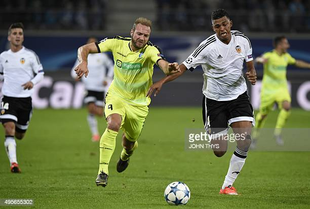 Ghent's Belgian forward Laurent Depoitre and Valencia's Brazilian defender Aderlan Santos vie for the ball during UEFA Champions League Group H...