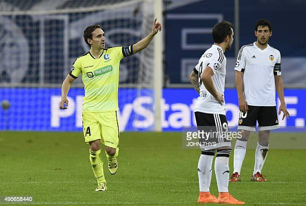 Ghent's Belgian midfielder Sven Kums celebrates after scoring the opening goal during the UEFA Champions League Group H secondleg football match...