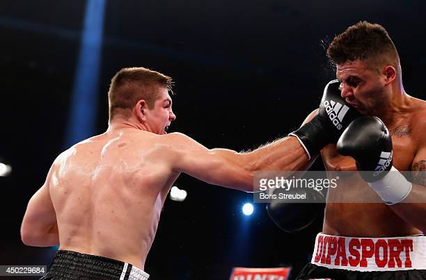 Gheorghe Sabau of Rumania and Vincent Feigenbutz of Germany exchange punches during their super middleweight fight at Sport und Kongresshalle on June...