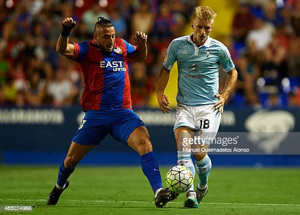 Ghilas of Levante competes for the ball with Daniel Wass of Celta de Vigo during the La Liga match between Levante UD and Real Club Celta de Vigo at...