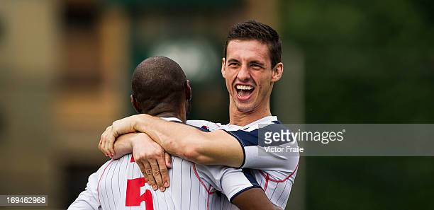 Ghislain Bell of Yau Yee League Select is congratulated by team mate Humberto Toscan after scoring against Manchester City on day two of the Hong...