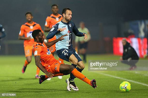 Ghislain Gimbert of Le Havre and Aaron Appindangoye of Laval during the Ligue 2 match between Stade Lavallois and Le Havre AC on November 4 2016 in...