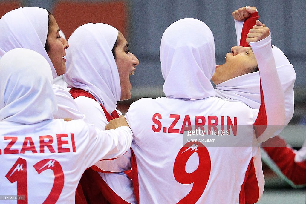 Gholami Nasimeh Sadat #6 of Iran celebrates with team mates Zarei Fahimeh #12 and Zarrinrad Sepideh #9 after scoring a goal against Japan during the Women's Futsal Gold Medal match at Songdo Global University Campus Gymnasium during day seven of the 4th Asian Indoor & Martial Arts Games on July 5, 2013 in Incheon, South Korea.