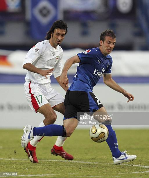 Gholamreza Enayati of Iran and Rafael van der Vaart of Hamburg fight for the ball during the Dubai Challenge Cup match between Hamburger SV and the...