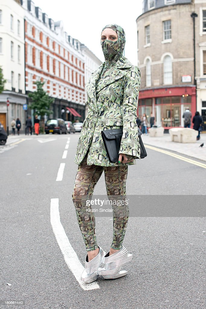 Ghost blogger Carmen Debeavoir wears Nude Republic shoes, Asos bag, leggings, top and jacket by Dans La Vie on day 3 of London Fashion Week Spring/Summer 2013, on September 15, 2013 in London, England.