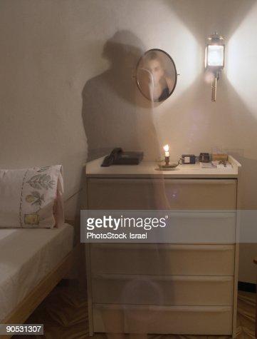 Ghost figure in bedroom,