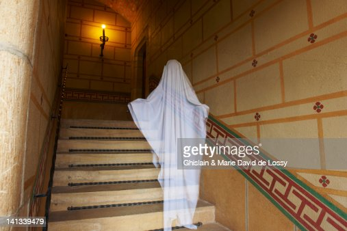 Ghost floating on ornate stairs