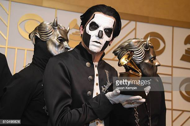 Ghost hold their Best Metal Performance trophy for 'Cirice' in the press room during The 58th GRAMMY Awards at Staples Center on February 15 2016 in...