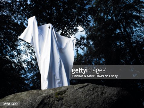 Ghost made of sheets, standing on a rock