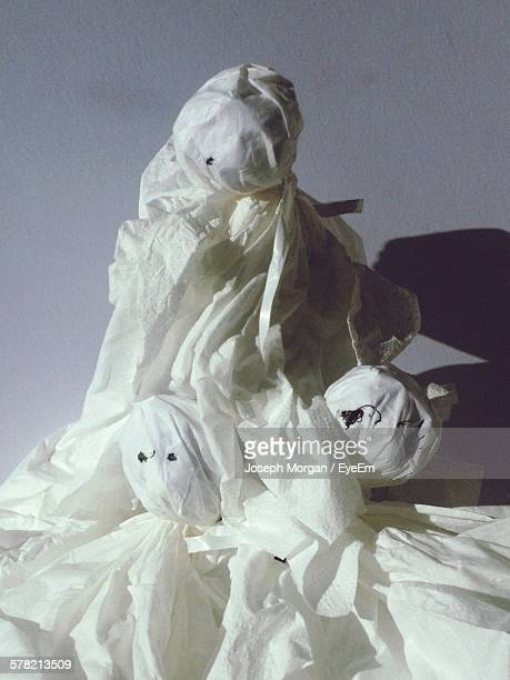 Ghost Made Of White Paper Against Wall