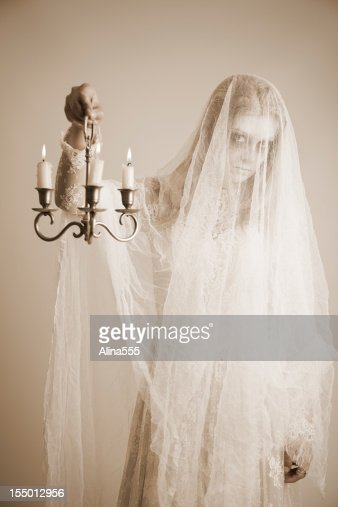 Ghost Of A Young Girl In White Dress Stock Photo | Getty