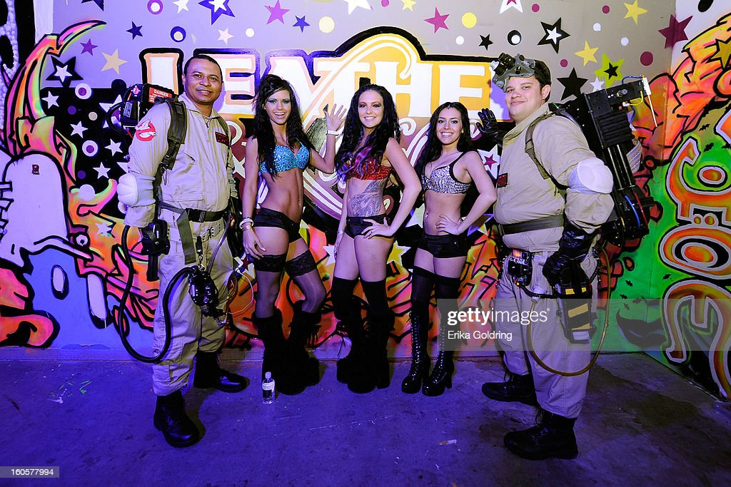 Ghostbusters and waitresses pose in front of a graffiti wall at the Tenth Annual Leather & Laces Super Bowl Party on February 2, 2013 in New Orleans, Louisiana.