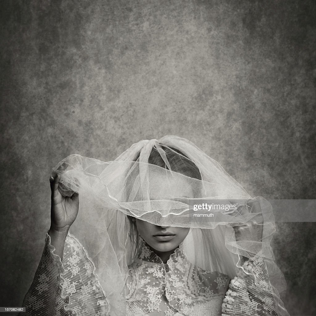 ghostly bride raising her veil : Stock Photo