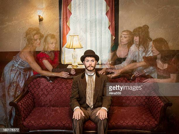 Ghosts of women haunting a man