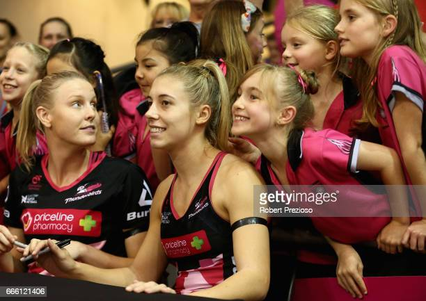 Gia Abernethy of the Thunderbirds signs autographs for fans during the round eight Super Netball match between the Thunderbirds and the Vixens at...