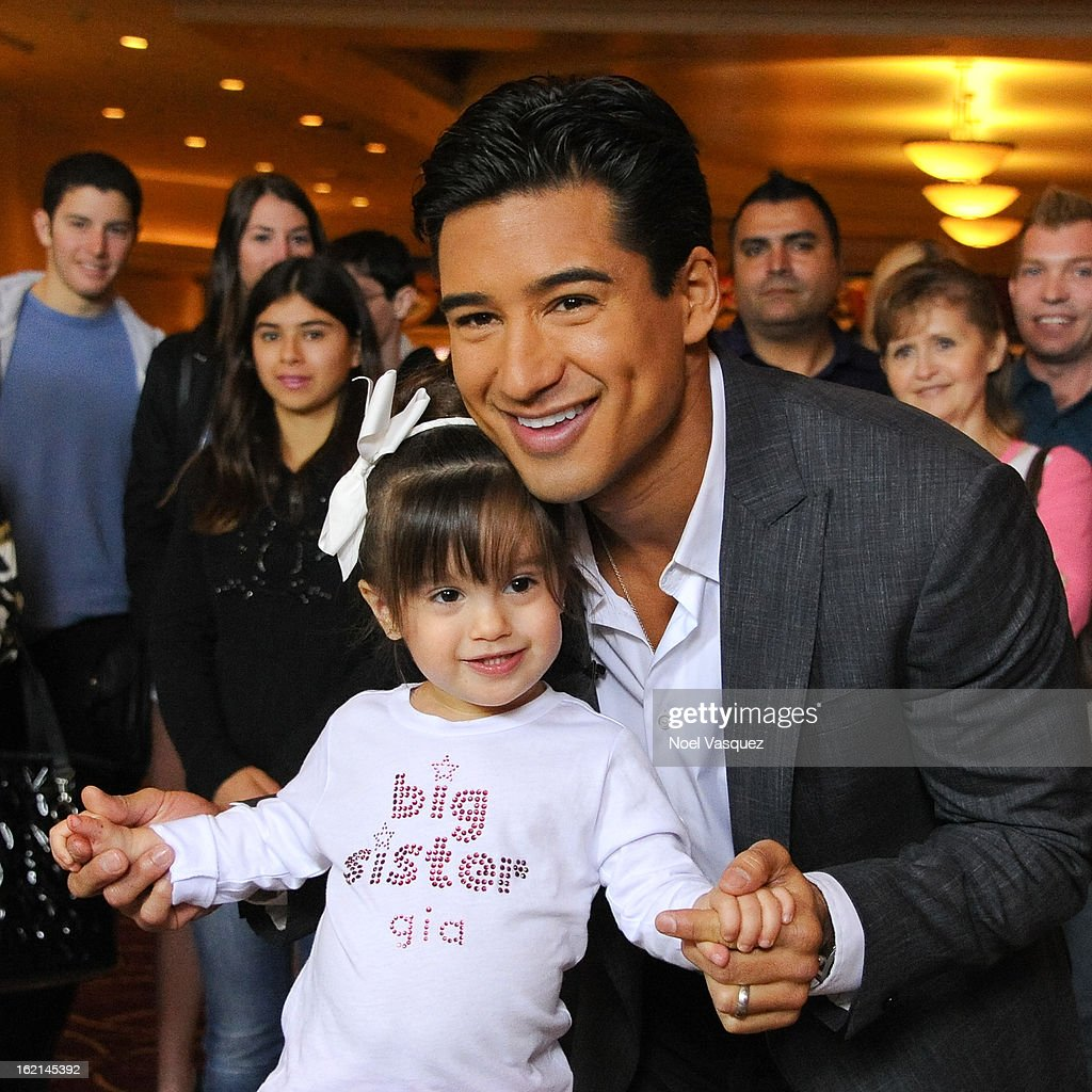 Gia and <a gi-track='captionPersonalityLinkClicked' href=/galleries/search?phrase=Mario+Lopez&family=editorial&specificpeople=235992 ng-click='$event.stopPropagation()'>Mario Lopez</a> announce his new baby at 'Extra' at The Grove on February 19, 2013 in Los Angeles, California.