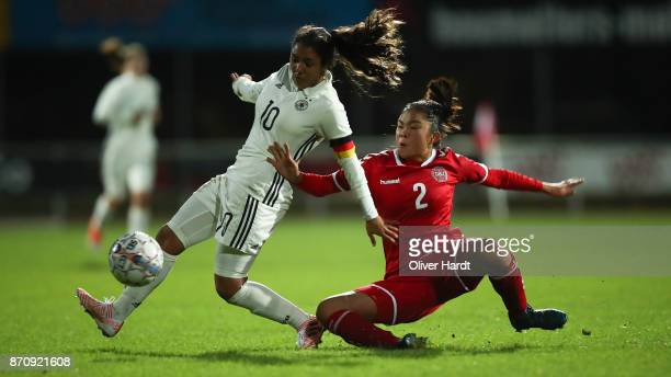 Gia Corley of Germany and Sofie Tranholm of Denmark compete for the ball during the U16 Girls international friendly match betwwen Denmark and...