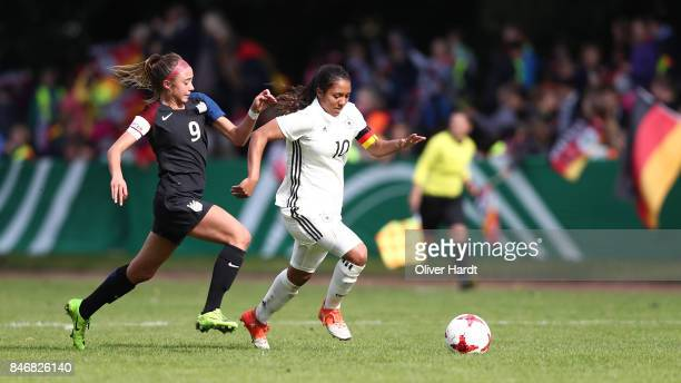 Gia Corley of Germany and Talia Dellaperuta of United States compete for the ball during the Girls U16 international friendly match between Germany...