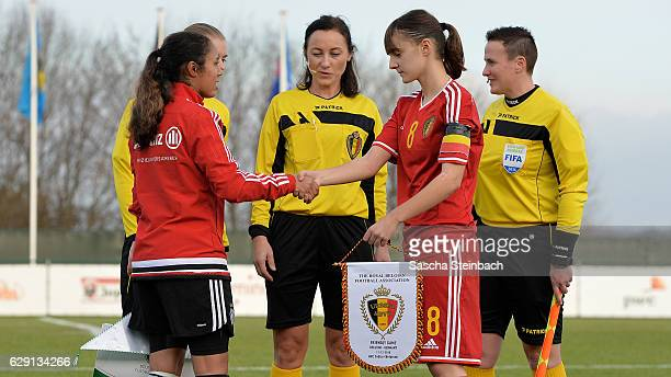 Gia Corley of Germany and Zenia Mertens of Belgium shake hands prior to during the U15 Girl's international friendly match between Belgium and...
