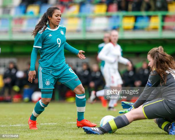 Gia Corley of Germany challenges goalkeeper Nikola Kucerova of Czech Republic for the ball during the Under 15 girls international friendly match...