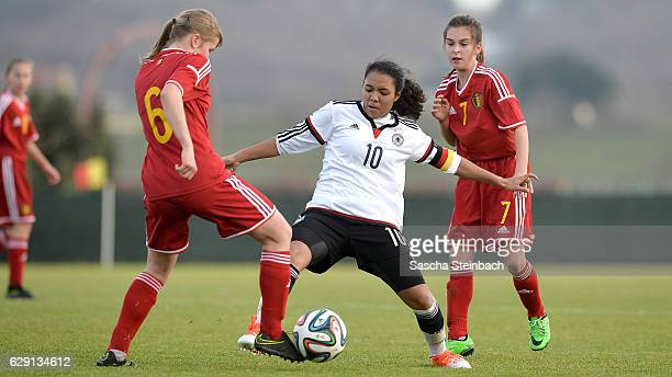 Gia Corley of Germany vies with Aster Janssens and Tess Wils of Belgium during the U15 Girl's international friendly match between Belgium and...
