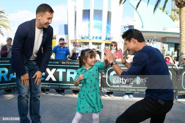 Gia Lopez and Mario Lopez play fight while Gennady Golovkin watches on at 'Extra' at Universal Studios Hollywood on February 28 2017 in Universal...