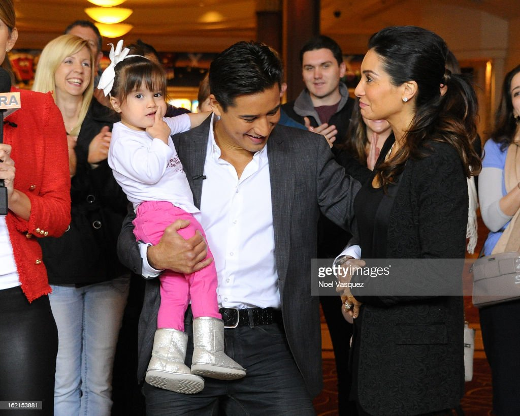 Gia Lopez, <a gi-track='captionPersonalityLinkClicked' href=/galleries/search?phrase=Mario+Lopez&family=editorial&specificpeople=235992 ng-click='$event.stopPropagation()'>Mario Lopez</a> and Courtney Mazza Lopez announce his their new baby at Extra at The Grove on February 19, 2013 in Los Angeles, California.