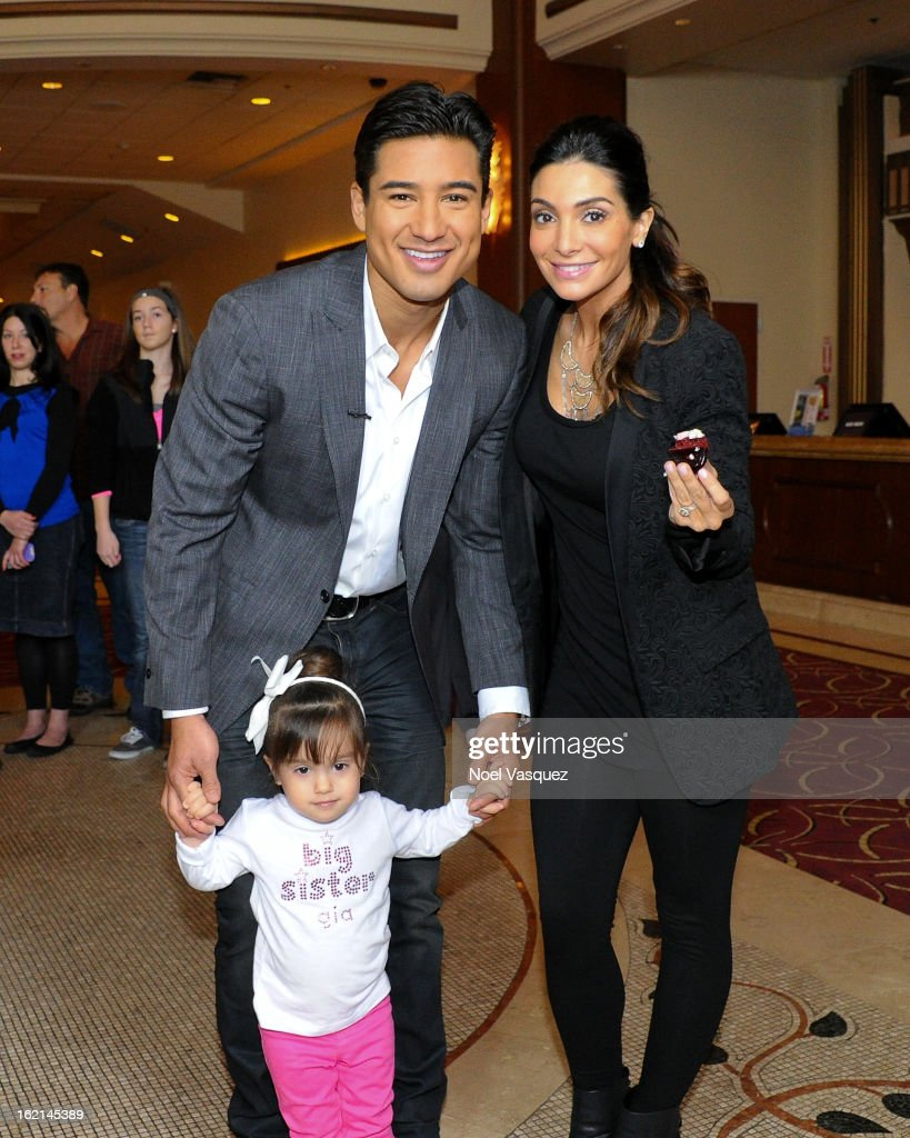 Gia, <a gi-track='captionPersonalityLinkClicked' href=/galleries/search?phrase=Mario+Lopez&family=editorial&specificpeople=235992 ng-click='$event.stopPropagation()'>Mario Lopez</a> and Courtney Mazza announce their new baby at 'Extra' at The Grove on February 19, 2013 in Los Angeles, California.