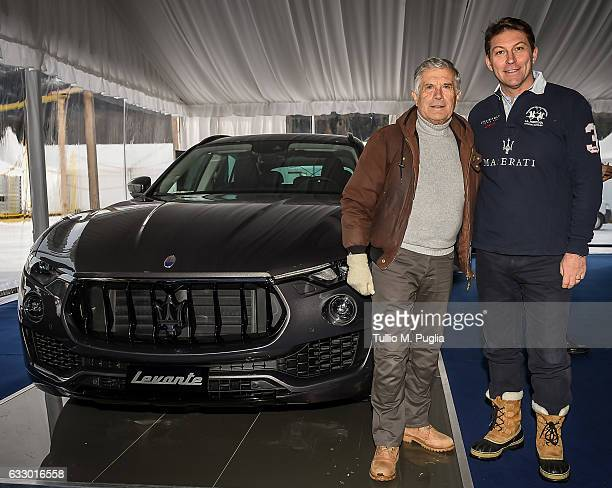 Giacomo Agostini former motorbike champion and Giulio Pastore General Manager of Maserati Europe pose near a Maserati Levante during Snow Polo World...