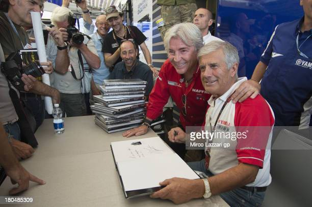 Giacomo Agostini of Italy during the presentation of his new book with Angel Nieto of Spain during MotoGP of San Marino Free Practice at Misano World...