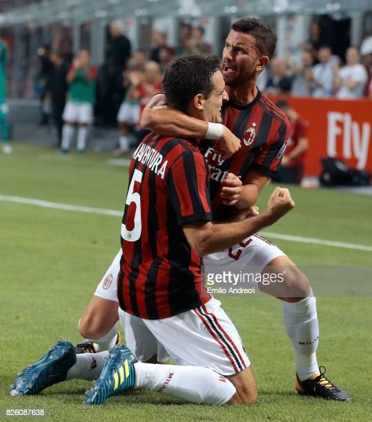 Giacomo Bonaventura of AC Milan celebrates with his teammate Mateo Pablo Musacchio after scoring the opening goal during the UEFA Europa League Third...
