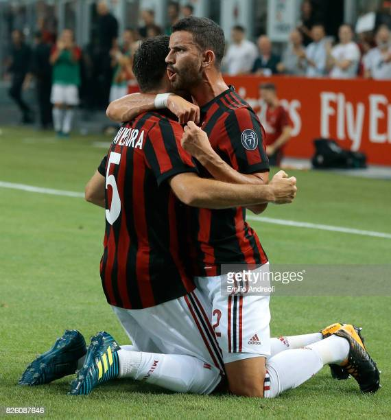 Giacomo Bonaventura of AC Milan celebrates with his teammate Mateo Pablo Musacchio after scoring the opening goal during the UEFA Europa League Third...