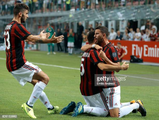 Giacomo Bonaventura of AC Milan celebrates with his teammates Mateo Pablo Musacchio and Patrick Cutrone after scoring the opening goal during the...