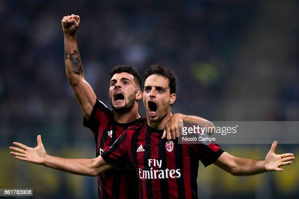 Giacomo Bonaventura of AC Milan celebrates with Patrick Cutrone after causing an own goal during the Serie A football match between FC Internazionale...
