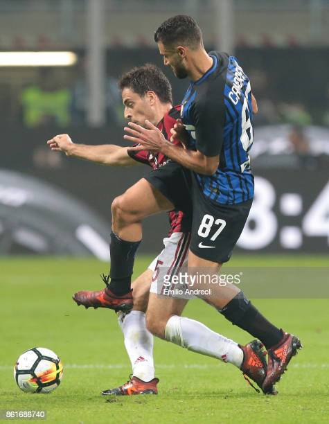 Giacomo Bonaventura of AC Milan competes for the ball with Antonio Candreva of FC Internazionale Milano during the Serie A match between FC...