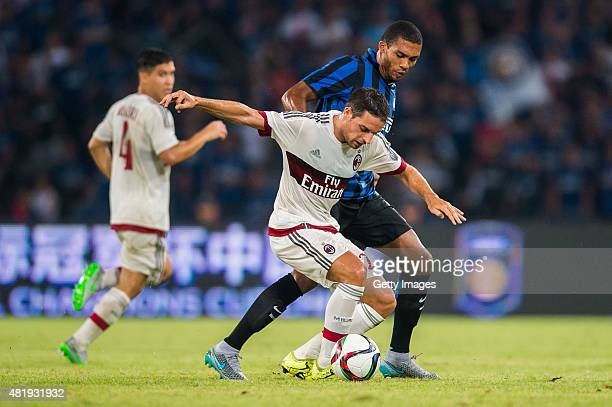 Giacomo Bonaventura of AC Milan competes for the ball with Juan Guilherme Nunes of FC Internazionale Milano during the AC Milan vs FC Internacionale...