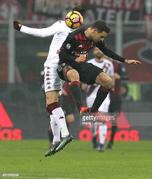 Giacomo Bonaventura of AC Milan competes for the ball with Marco Benassi of Torino FC during the TIM Cup match between AC Milan and AC Torino at...