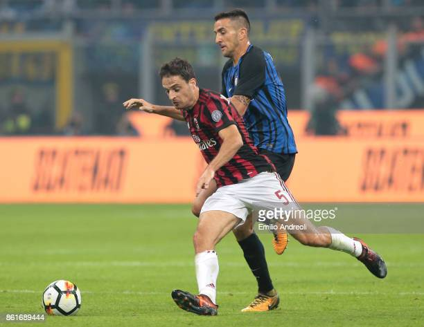 Giacomo Bonaventura of AC Milan competes for the ball with Matias Vecino of FC Internazionale Milano during the Serie A match between FC...