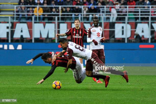 Giacomo Bonaventura of AC Milan competes for the ball with Tomas Ricon of Torino FC during Italian serie A match AC Milan vs Torino FC at San Siro...