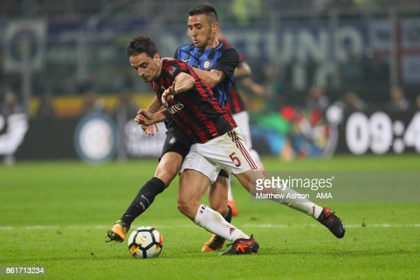 Giacomo Bonaventura of AC Milan gets fouled by Matias Vecino of Internazionale during to the Serie A match between FC Internazionale and AC Milan at...