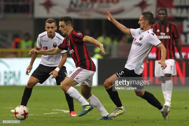 Giacomo Bonaventura of AC Milan is challenged by Armend Alimi of KF Shkendija 79 during the UEFA Europa League Qualifying PlayOffs round first leg...