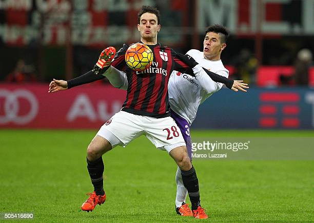 Giacomo Bonaventura of AC Milan is challenged by Facundo Roncaglia of ACF Fiorentina during the Serie A match between AC Milan and ACF Fiorentina at...