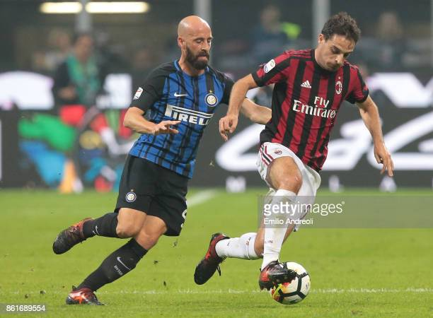 Giacomo Bonaventura of AC Milan is challenged by Iglesias Borja Valero of FC Internazionale Milano during the Serie A match between FC Internazionale...