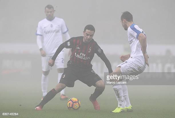 Giacomo Bonaventura of AC Milan is challenged by Jasmin Kurtic of Atalanta BC during the Serie A match between AC Milan and Atalanta BC at Stadio...